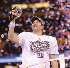 Eli Manning Holds the LombardiTrophy