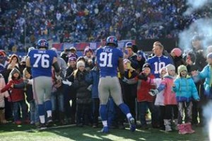 The Giants greeting children from Sandy Hook