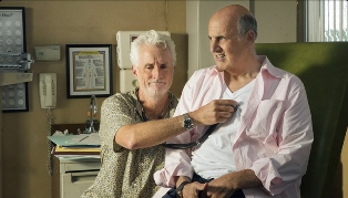 John Slattery as Dr. Norman with George Sr.